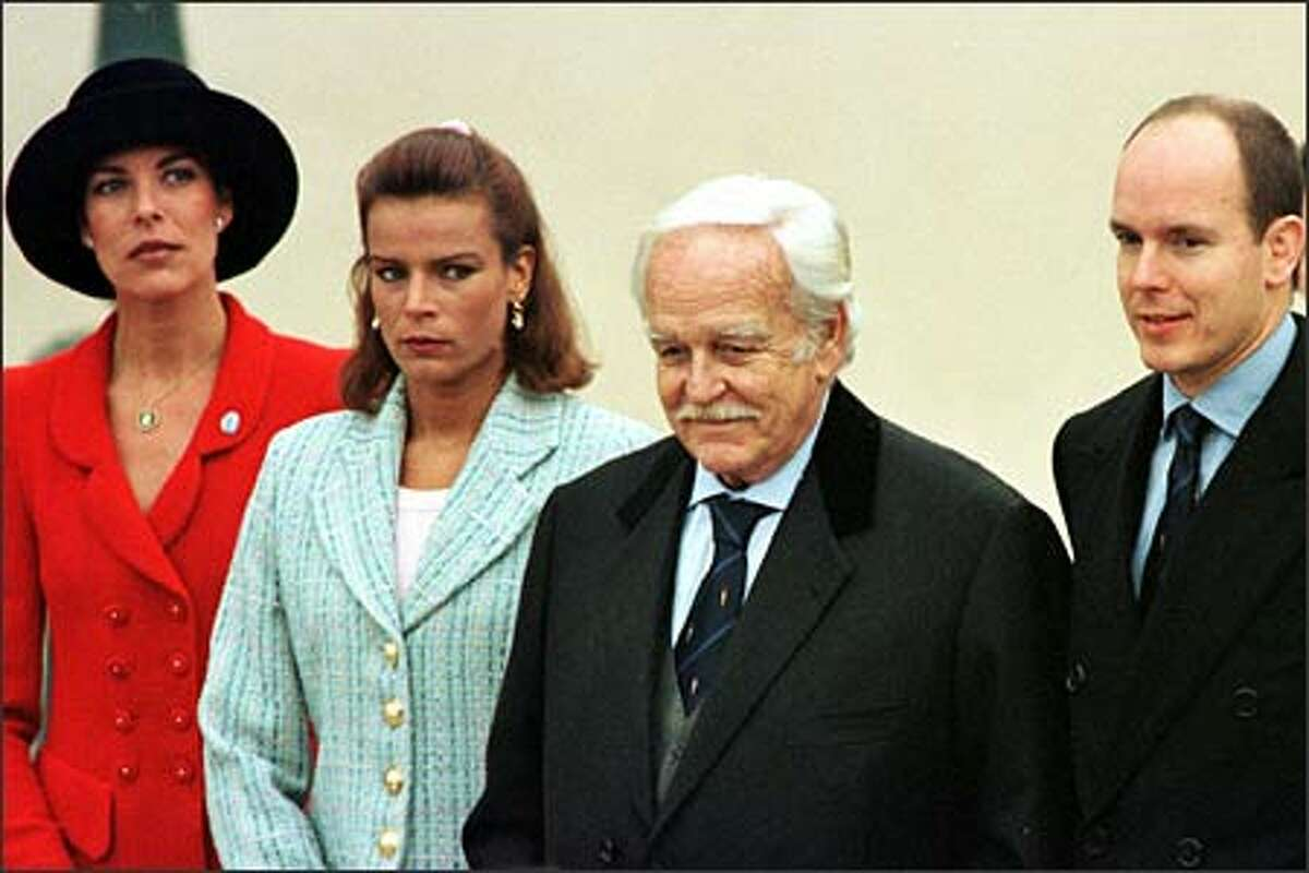 Princess Caroline, far left, Princess Stephanie, the late Prince Rainier III, whose funeral is being held today, and Prince Albert are shown here in a 1997 celebration for the 700th anniversary of the Grimaldi family's reign. The siblings were not remembered equally in their father's will, with wild child Stephanie getting