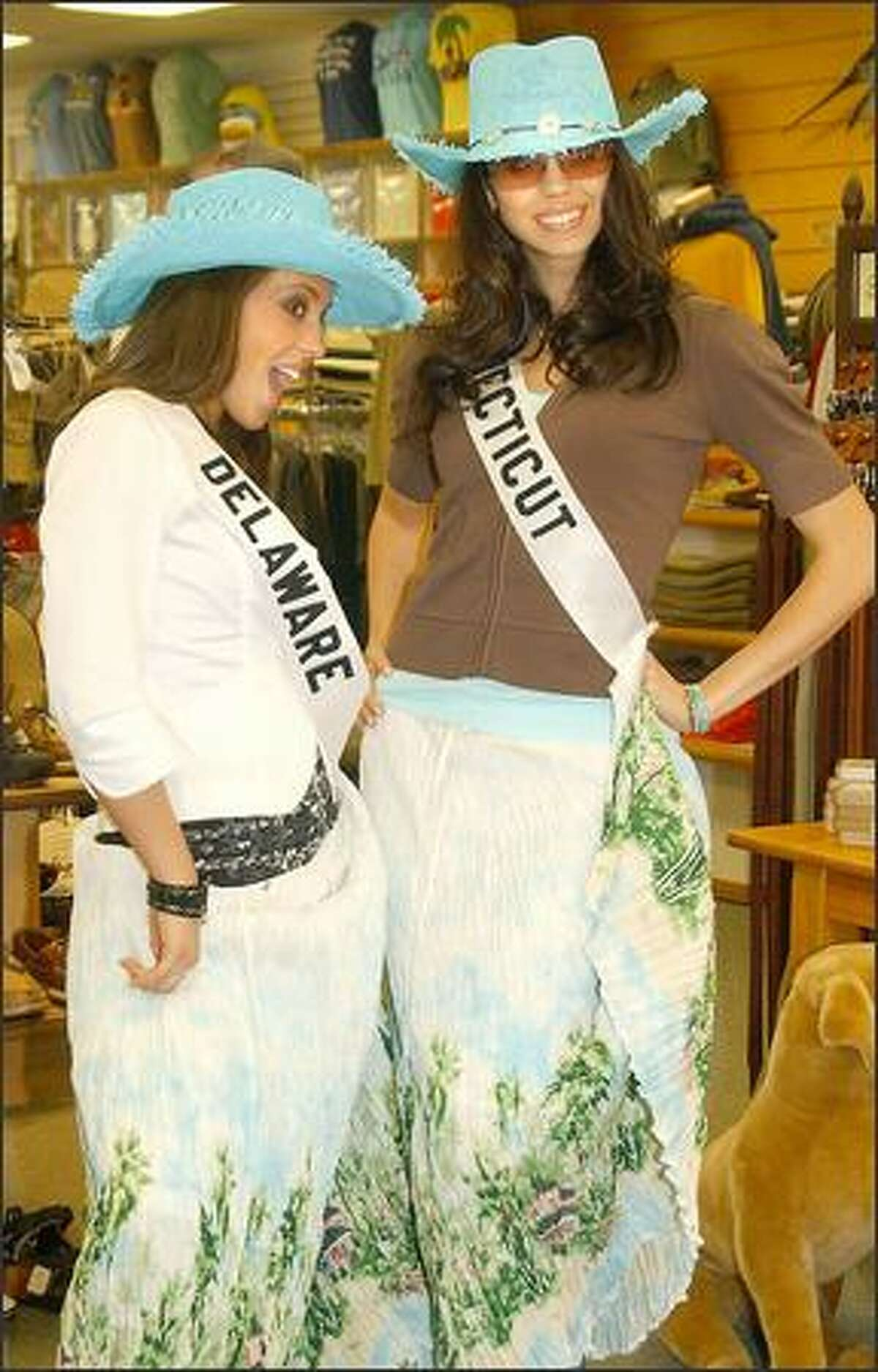 Miss USA contestants Miss Delaware Ashlee Greenwell, left, and Miss Connecticut Jeannine Phillips model some of Maryland's gaudier garb from Chesapeake Bay Outfitters as they tour the state in preparation for the competition, April 21 in Baltimore.