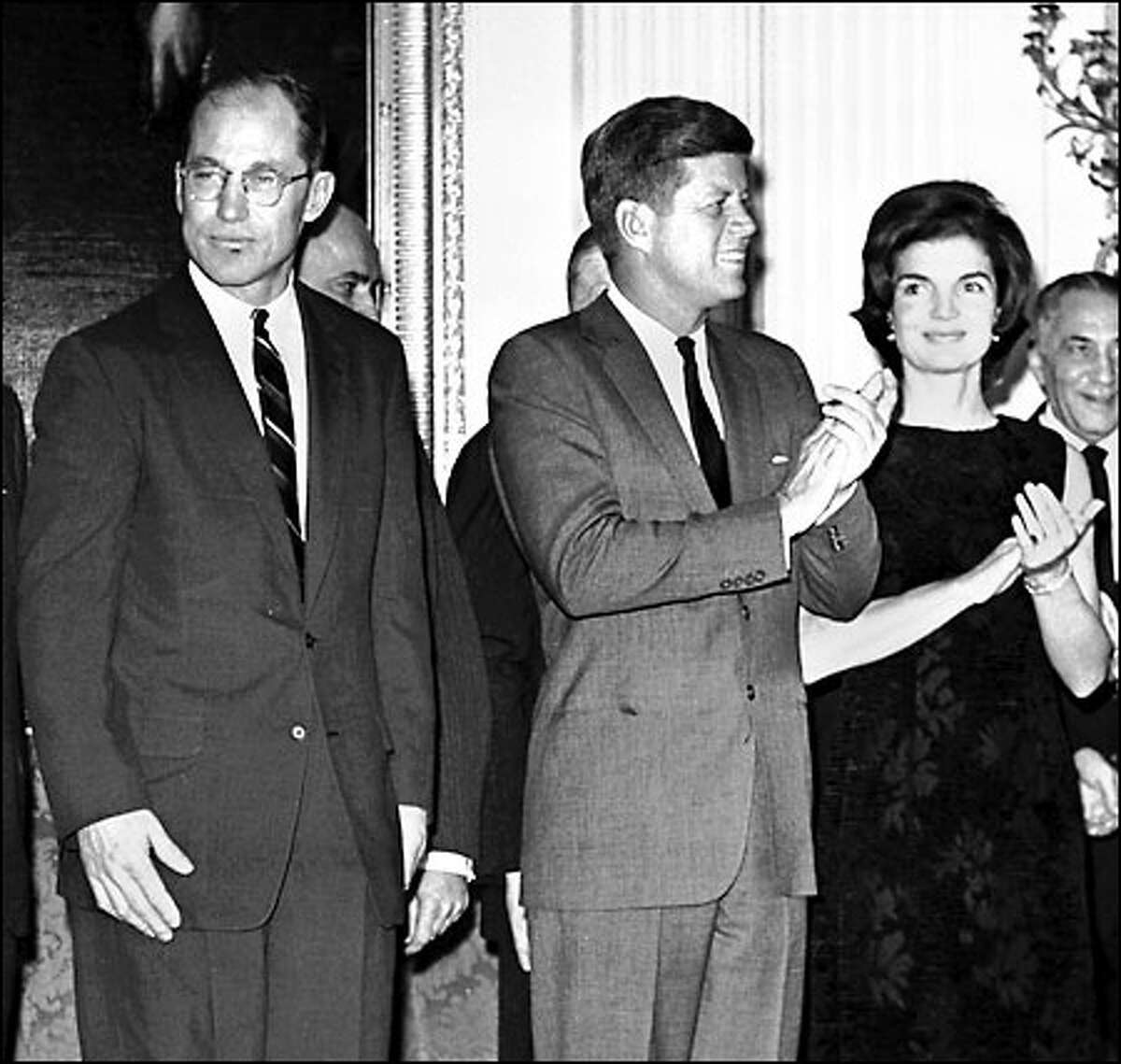 Byron White, left, is pictured with President Kennedy and his wife, Jacqueline, at the White House. Kennedy appointed White a justice in 1962.