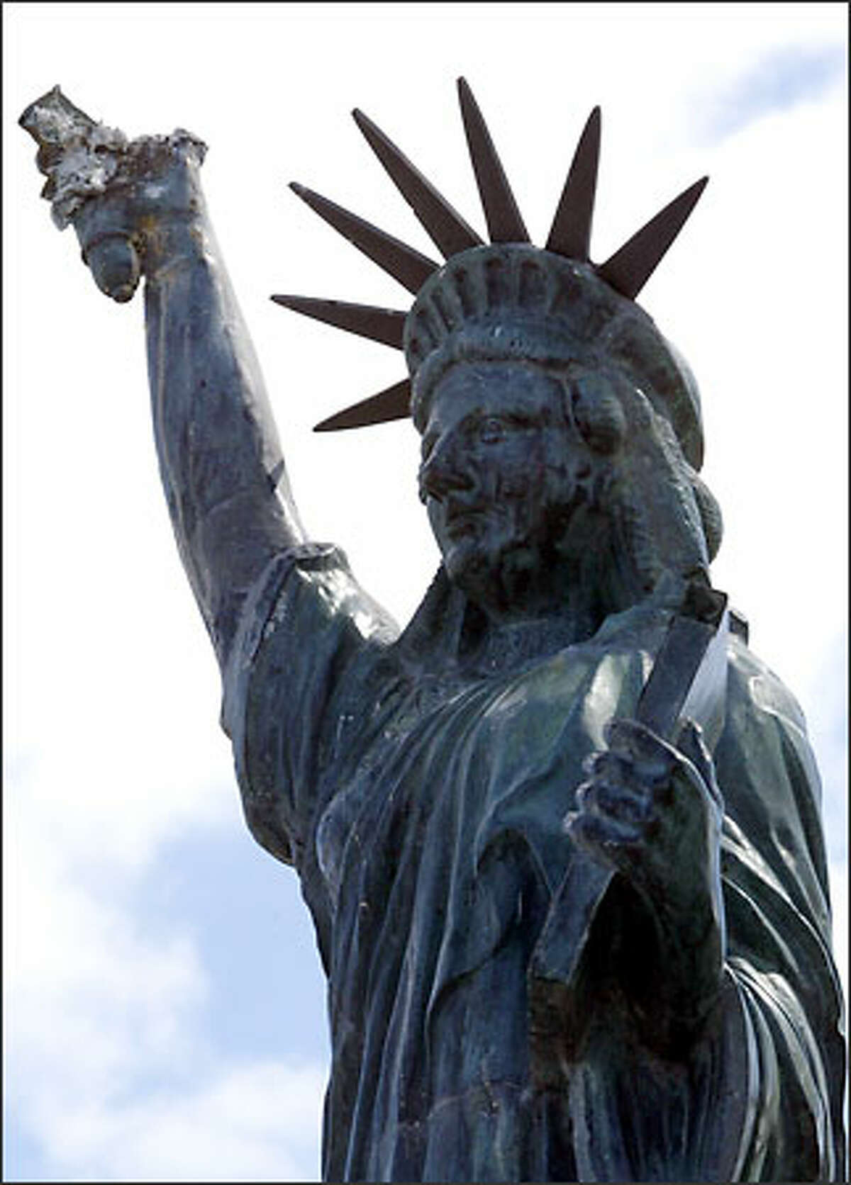 Alki Beach residents fear the statue damage may be hard to repair.