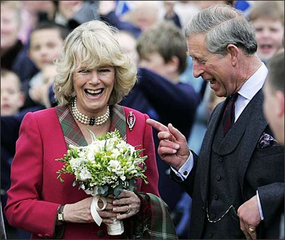 No matter how you feel about Camilla, duchess of Cornwall, you have to admit that she and the likely future king of England look happy together. She and Charles appeared at the opening of a new park in Scotland on Thursday -- their first public engagement since their marriage last Saturday. (ANDREW MILLIGAN/AP) Photo: Associated Press / Associated Press
