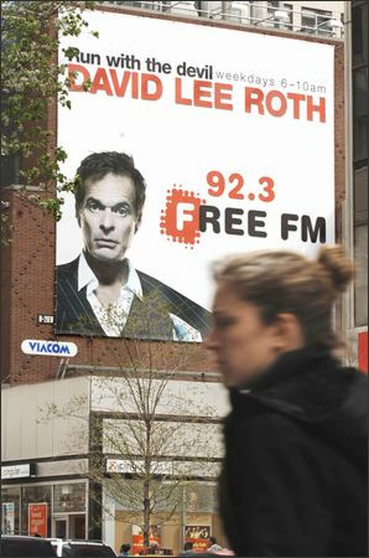 David Lee Roth, looking like a middle-age business guy and not the once goofy glam-rockin' frontman for Van Halen, looms above midtown Manhattan in a desperate attempt for attention as his numbers as Howard Stern's replacement continue to plummet.