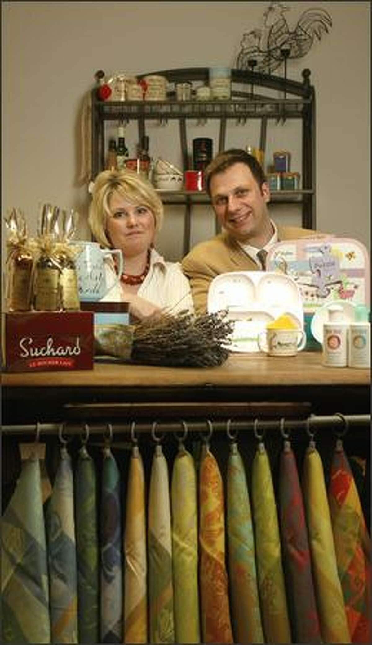 Lisa and Hugues Deriau display some of The Frenchy Bee's products, including French kitchen towels.