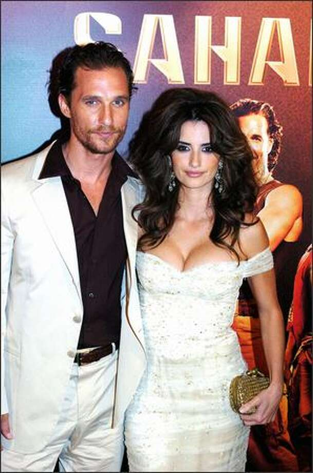 "Penelope Cruz's bustline appears to offer at least as much drama as ""Sahara,"" the new movie starring her and boyfriend Matthew McConaghey. The two appeared last week at the Spain opening of their film. (ALBERTO MARTIN/AP) Photo: Associated Press / Associated Press"