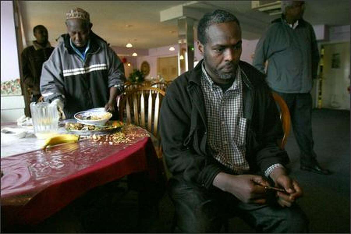 Jama Absiya, at a restaurant with friends, was among 18 men arrested last year by the DEA on accusations they were part of an international khatsmuggling operation. Charges were dropped against Absiya, but five others still are fighting charges, saying they use the stimulant only occasionally.