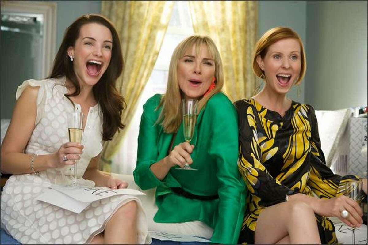 Charlotte (Kristin Davis, left), Samantha (Kim Cattrall, center) and Miranda (Cynthia Nixon, right) enjoy themselves in the
