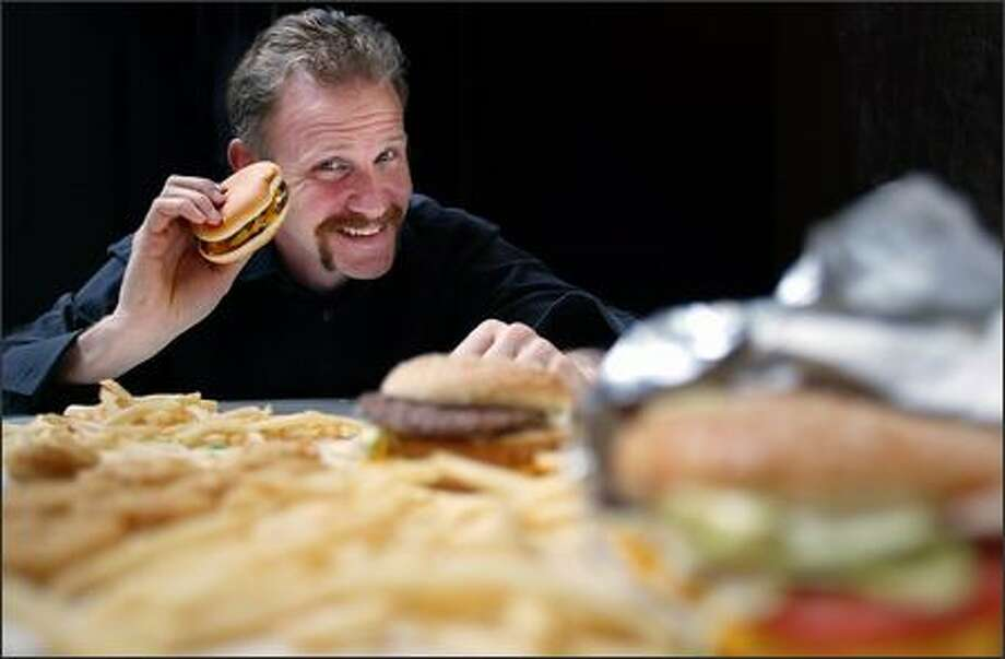"Morgan Spurlock is all smiles as he promotes his film ""Super Size Me,"" but it was a very different picture when he was eating nothing but McDonald's. Photo: Paul Joseph Brown, Seattle Post-Intelligencer / Seattle Post-Intelligencer"