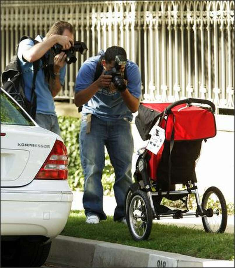 We know paparazzi live on a certain measure of desperation -- a glimpse, a sneak peek, an expression can fuel paychecks -- but an empty baby stroller? If it belongs to TomKat, they will shoot it. This Baby Jogger was beset by snapping shutters almost as soon as it was set in front of Cruise's house for delivery. Photo: Associated Press / Associated Press