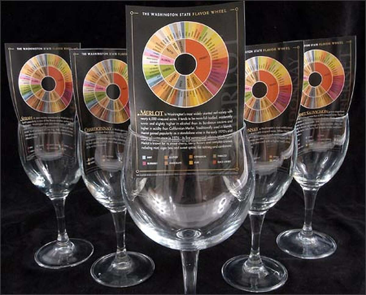 Flavor wheels, shown inserted in wine glasses in Yakima, give information on wines as well as a palette of flavor options for the palate.