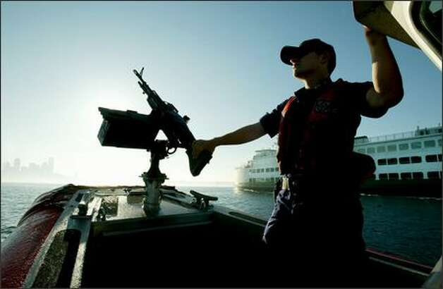 After the Seattle FBI office released an assessment of potential threats in 2004, steps were taken to improve security on ferries, including Coast Guard escorts. Photo: Paul Joseph Brown, Seattle Post-Intelligencer / Seattle Post-Intelligencer