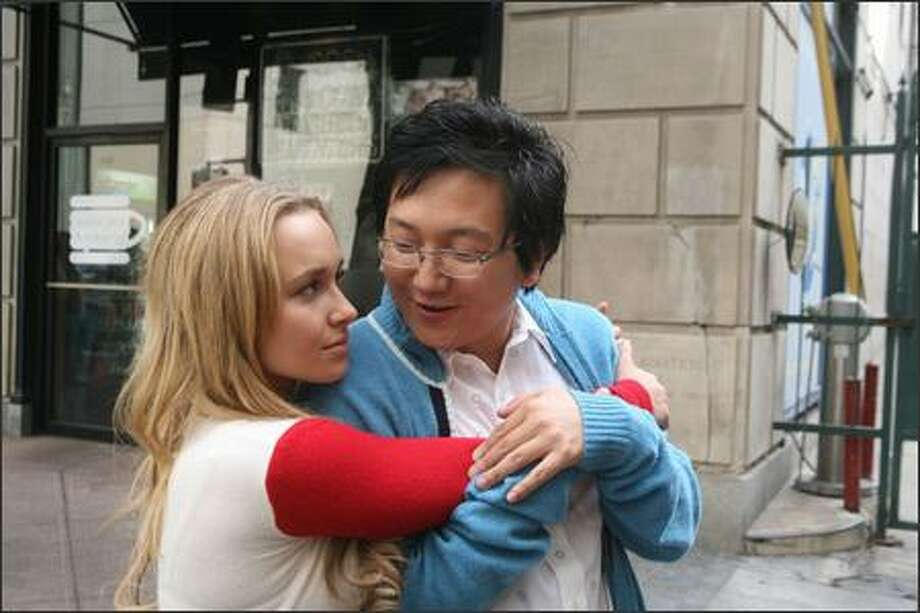 """""""Save the cheerleader, save the world."""" Hayden Panettiere as  Claire Bennet in the television show """"Heroes"""" has to be one of the most recognizable fictional cheerleaders ever. Here she is in a behind-the-scenes shot with Masi Oka having fun while filming the Jan. 22 episode, """"Godsend."""" Photo: NBC / NBC"""