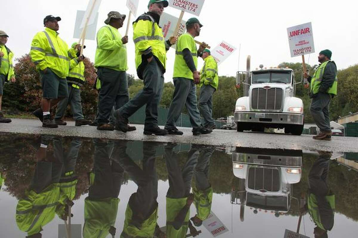 Drivers walk the picket line at a Waste Management facility in South Park after Teamsters Local 174 decided to strike, halting garbage service for hundreds of thousands of customers.
