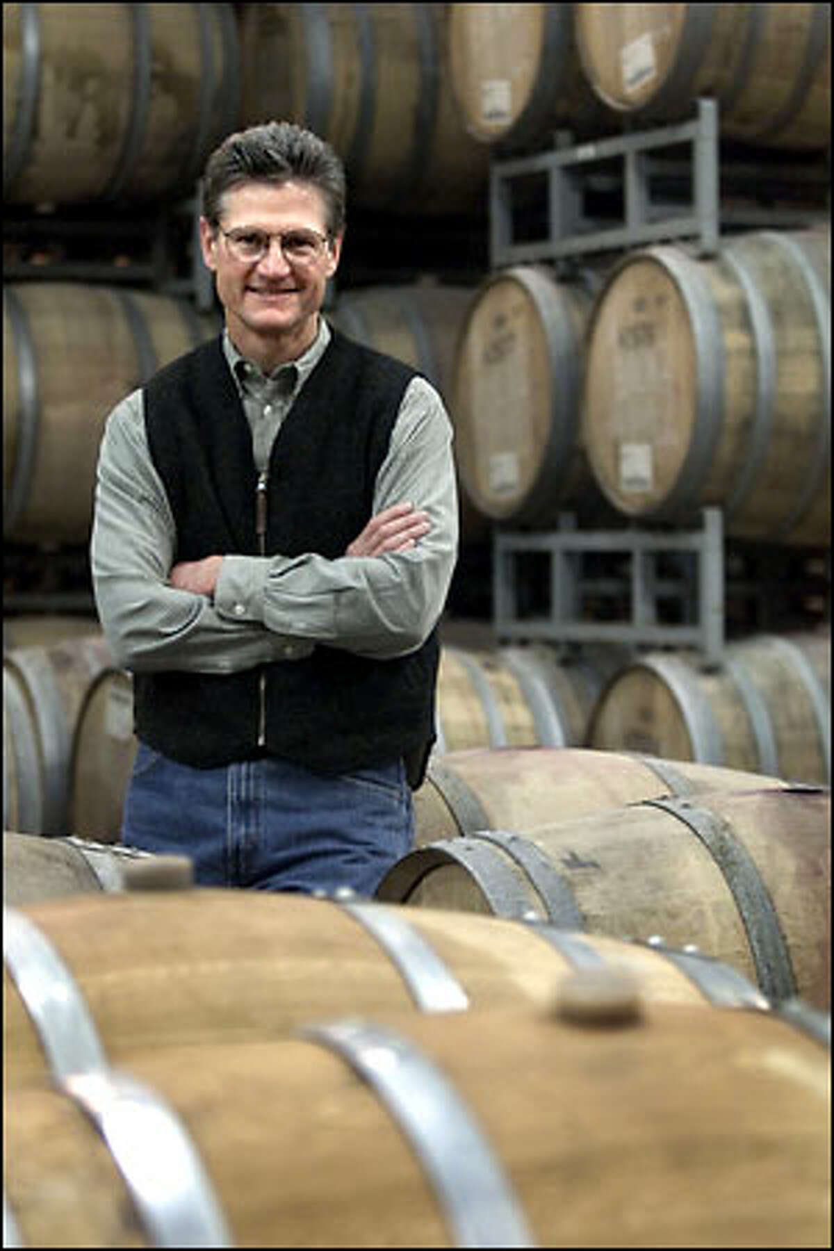 Wade Wolfe, general manager of Hogue Cellars in Prosser, says that despite California wineries lowering their wine prices because of the economic downturn, Hogue has no plans to drop its prices. Higher demand may help lift prices.
