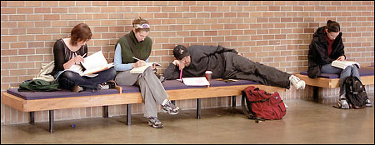 Students at the University of Washington study between classes. Corporate recruiting on campus is down about 40 percent because of the recession.