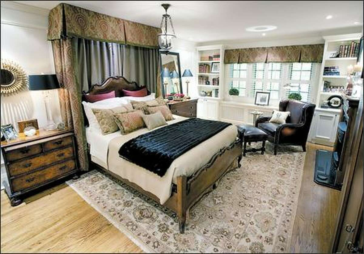 A dark bedroom was given a country-manor look with handcrafted furniture and traditional fabrics.