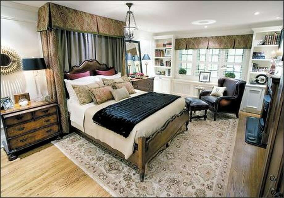A dark bedroom was given a country-manor look with handcrafted furniture and traditional fabrics. Photo: HGTV / HGTV