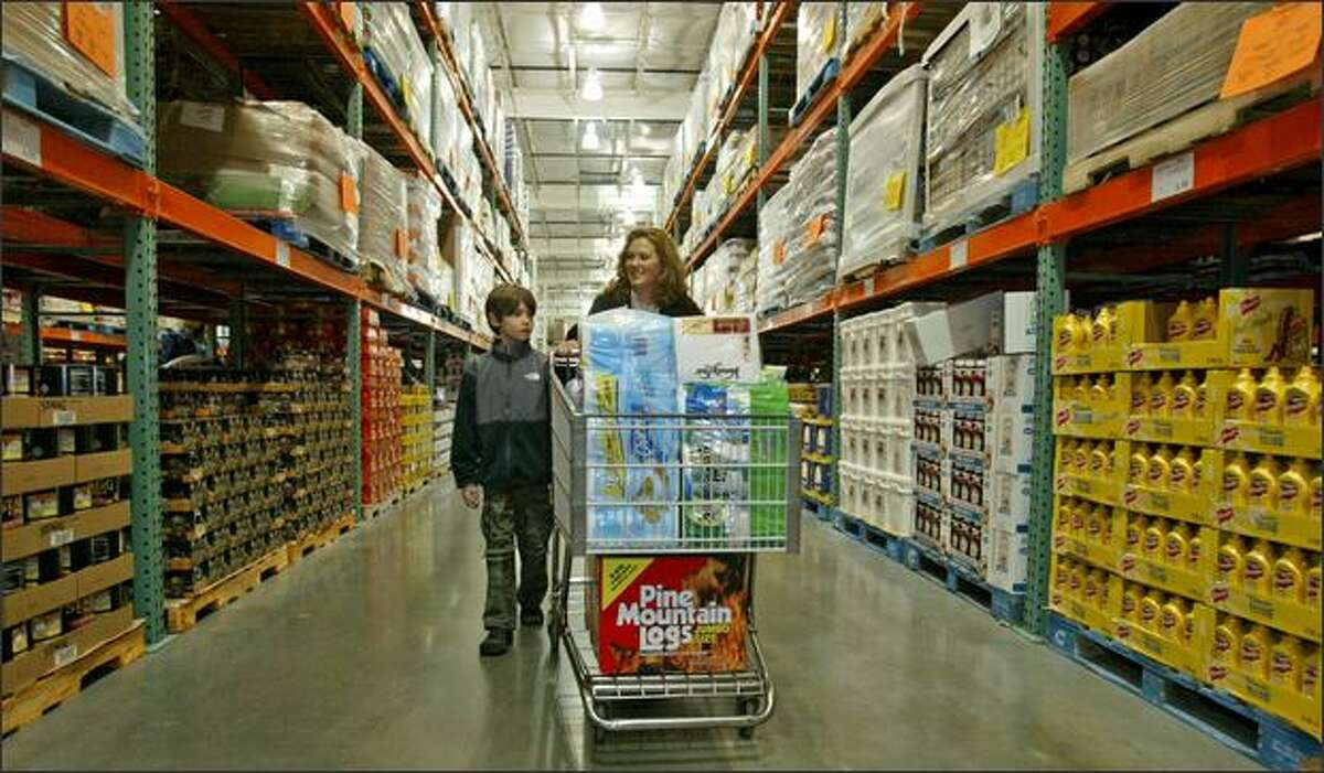 Deborah Yand and her son Nicholas, 9, shop at Costco on Fourth Avenue South in Seattle on Jan. 10, 2008.