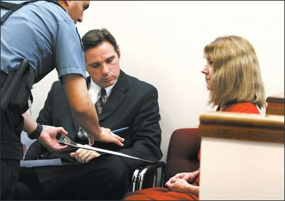Deana Jarrett, the former police detective who troopers said recorded the highest blood-alcohol concentration -- 0.47 -- in state history, pleaded not guilty Monday to drunken driving. Jarrett's lawyer, Raymond Ejarque, in on her right. Photo: Meryl Schenker, Seattle Post-Intelligencer / Seattle Post-Intelligencer