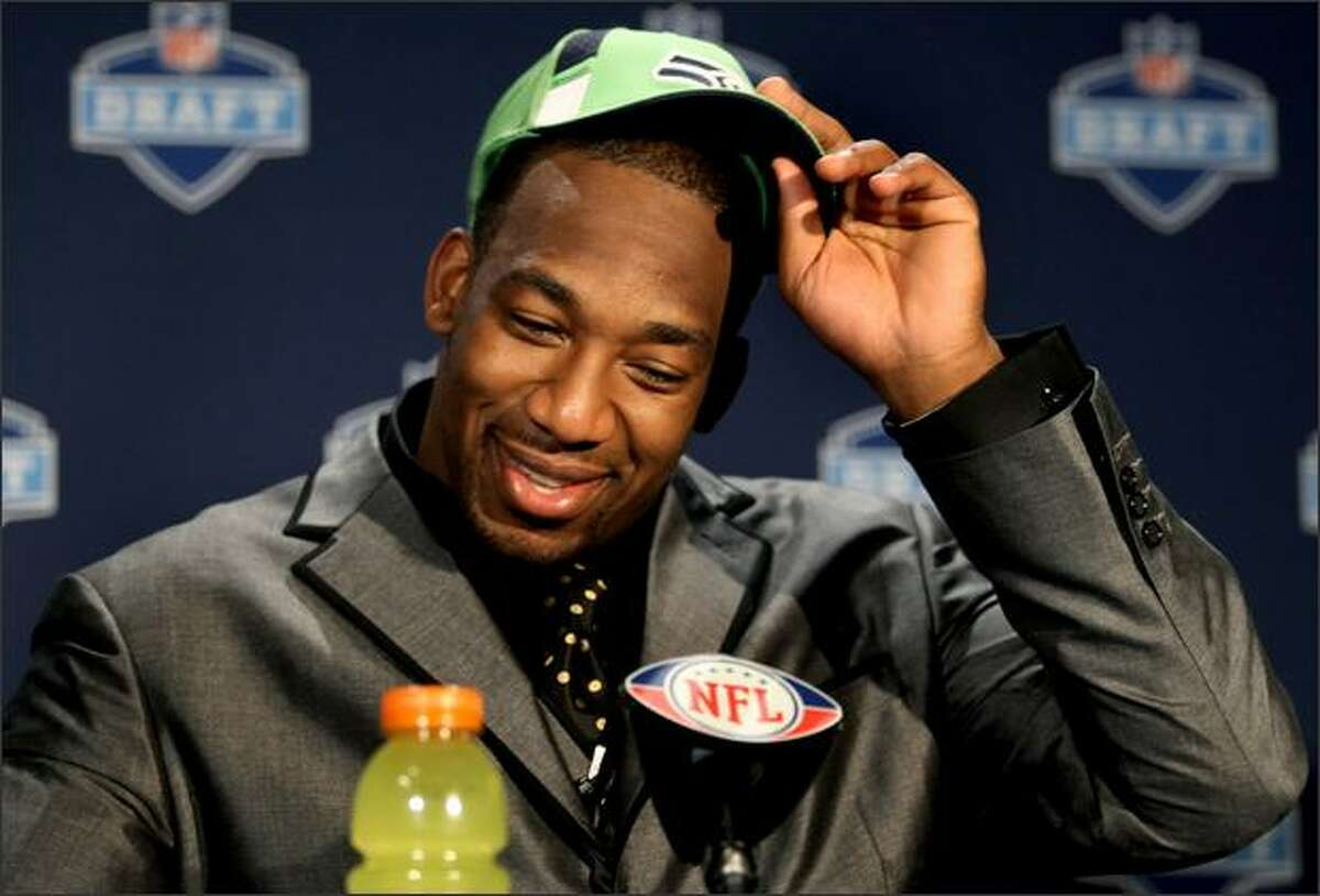 Linebacker Aaron Curry adjust his cap as he speaks to the media after being selected fourth overall in the first round of the NFL Draft by the Seattle Seahawks, Saturday, April 25, 2009, at Radio City Music Hall in New York. (AP Photo/Craig Ruttle)