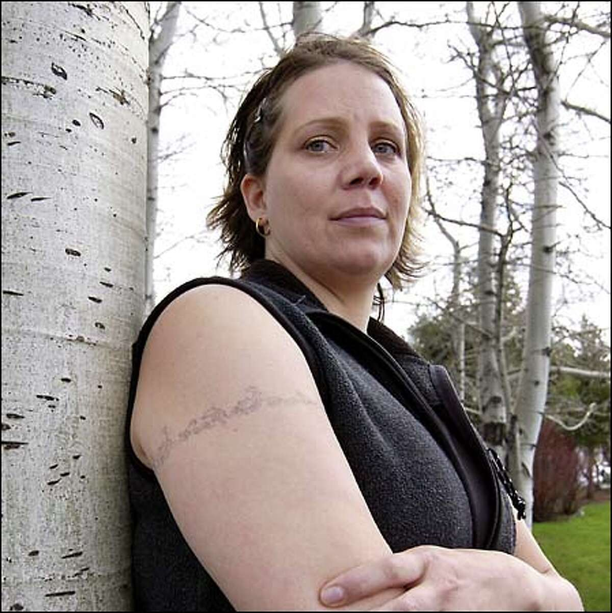 Dental hygienist Christine Cooper believes she contracted hepatitis C sometime between 1995 and 1997, after getting two tattoos at the same tattoo salon.