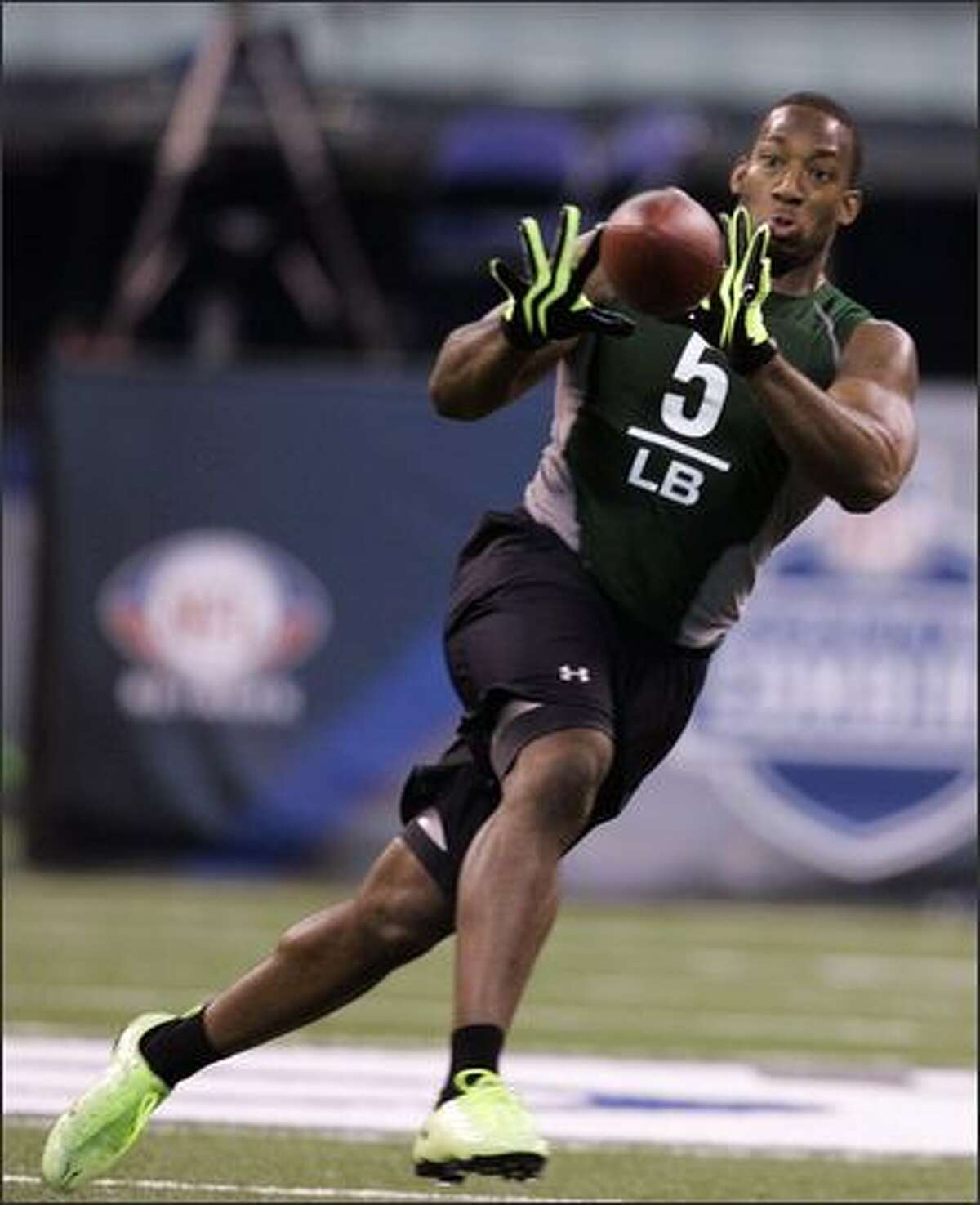 In this Feb. 23, 2009 file photo, Wake Forest linebacker Aaron Curry runs a drill at the NFL football scouting combine in Indianapolis. Curry is a top prospect in the 2009 NFL Draft. (AP Photo/Darron Cummings, File)