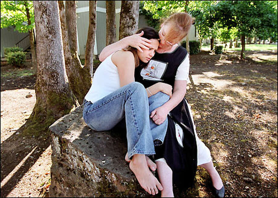 Five years ago, Autumn Chandler was driven out of the Washington School for the Deaf after she reported being raped by a popular football player in the woods near her home. Afterward, Autumn said she was threatened on campus by Justin Mastrud, the 17-year-old boy charged with raping her. Autumn, now 20, is comforted by her mother, Claudia, in Vancouver. Mastrud pleaded guilty in May 1996 to communicating with a minor for immoral purposes. Photo: Renee C. Byer, Seattle Post-Intelligencer / Seattle Post-Intelligencer