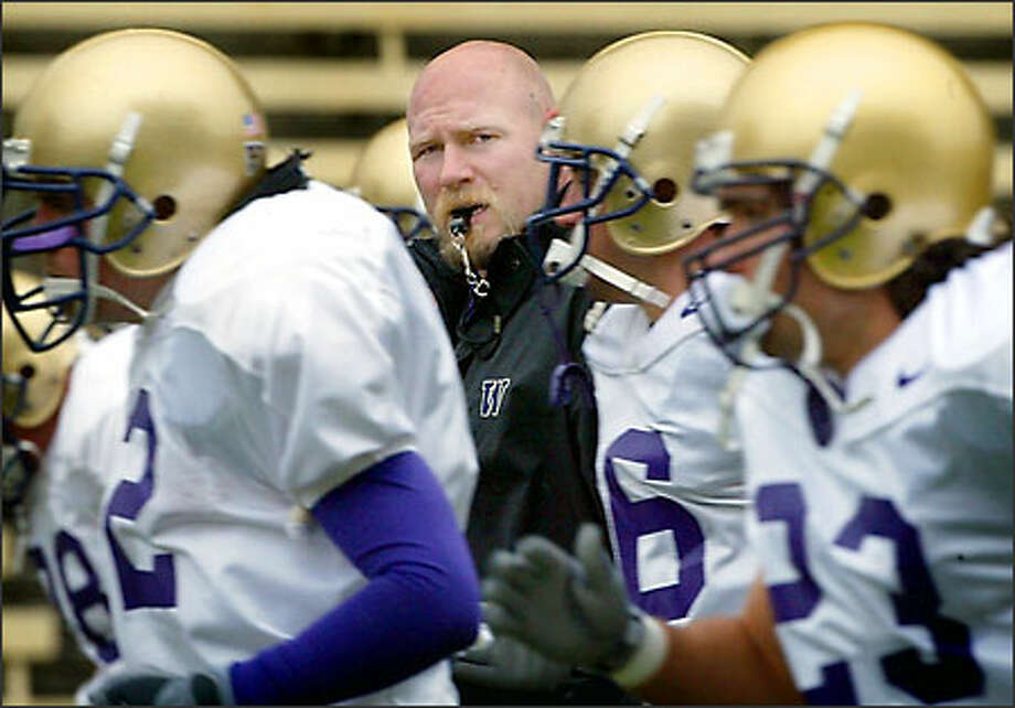 Former Husky All-American Steve Emtman here with the team during Monday's practice has become an offical assistant coach. Photo: Gilbert W. Arias, Seattle Post-Intelligencer / Seattle Post-Intelligencer