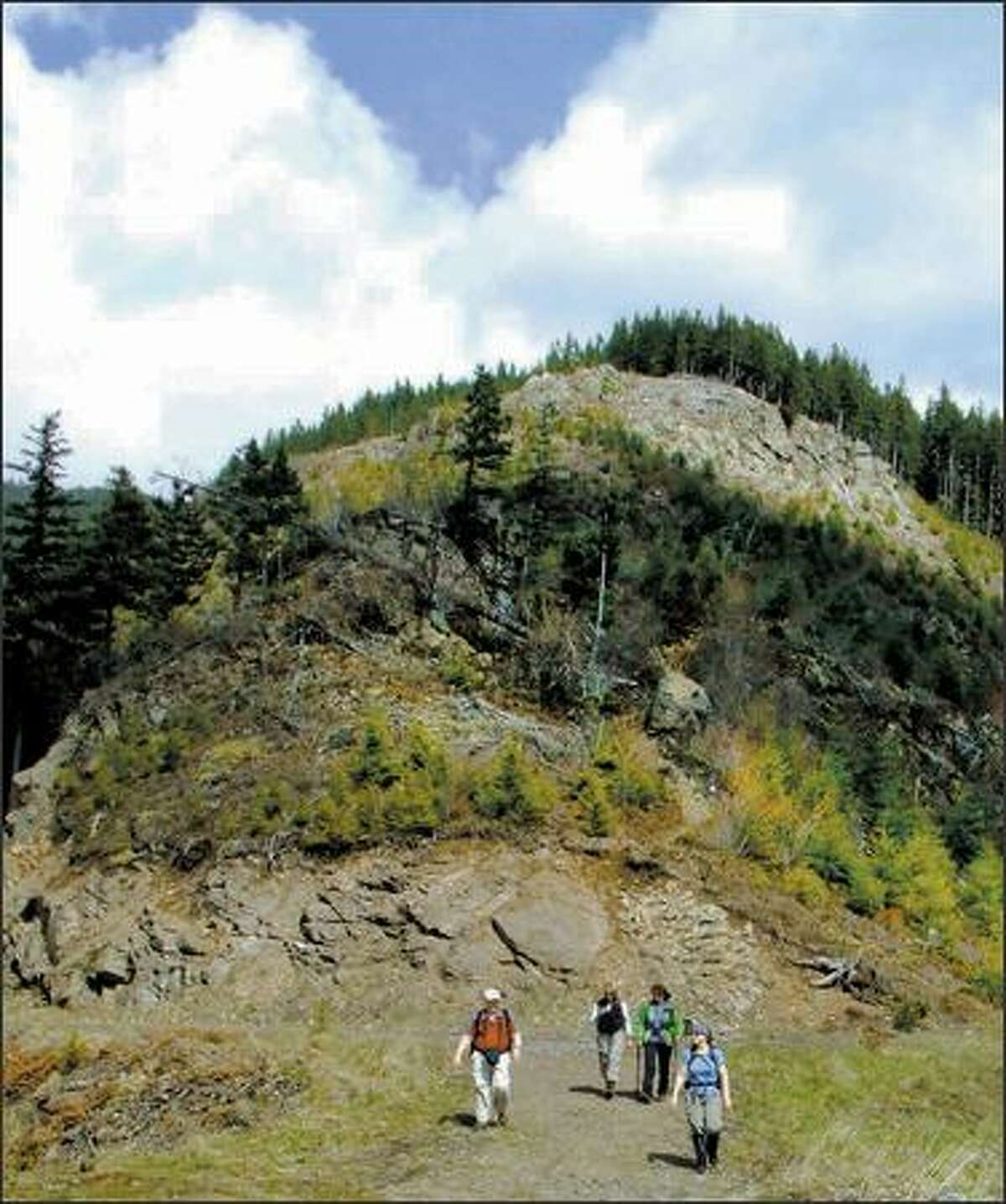 Clearcutting has laid bare the rocky ribs of a ridge along the Christoff Trail.