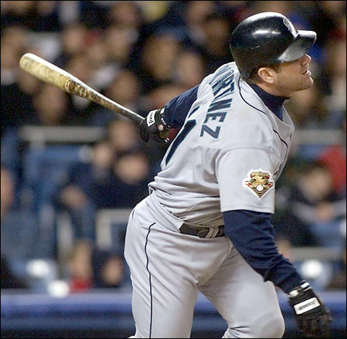 Designated hitter Edgar Martinez, lacing a tiebreaking, two-run double to left-center in the seventh inning, went 3 for 5, driving in four runs and raising his average from .314 to .333.