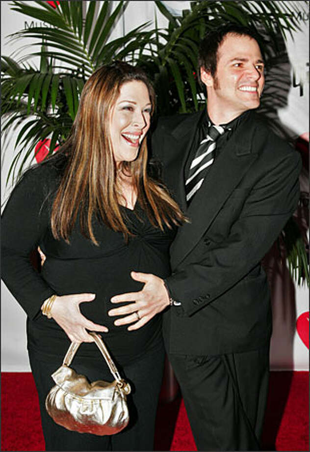 Carnie Wilson and her husband, Rob Bonfiglio, are parents of a baby girl, Lola Sophia. She is the first child for the couple, shown here at a tribute to Carnie's father, Brian Wilson, in February. The baby, born in Los Angeles, weighed 7 pounds, 2 ounces. Photo: Associated Press / Associated Press