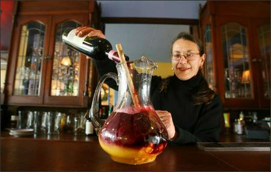 Jo Luna mixes a pitcher of sangria at Gaudi. Photo: Scott Eklund, Seattle Post-Intelligencer / Seattle Post-Intelligencer