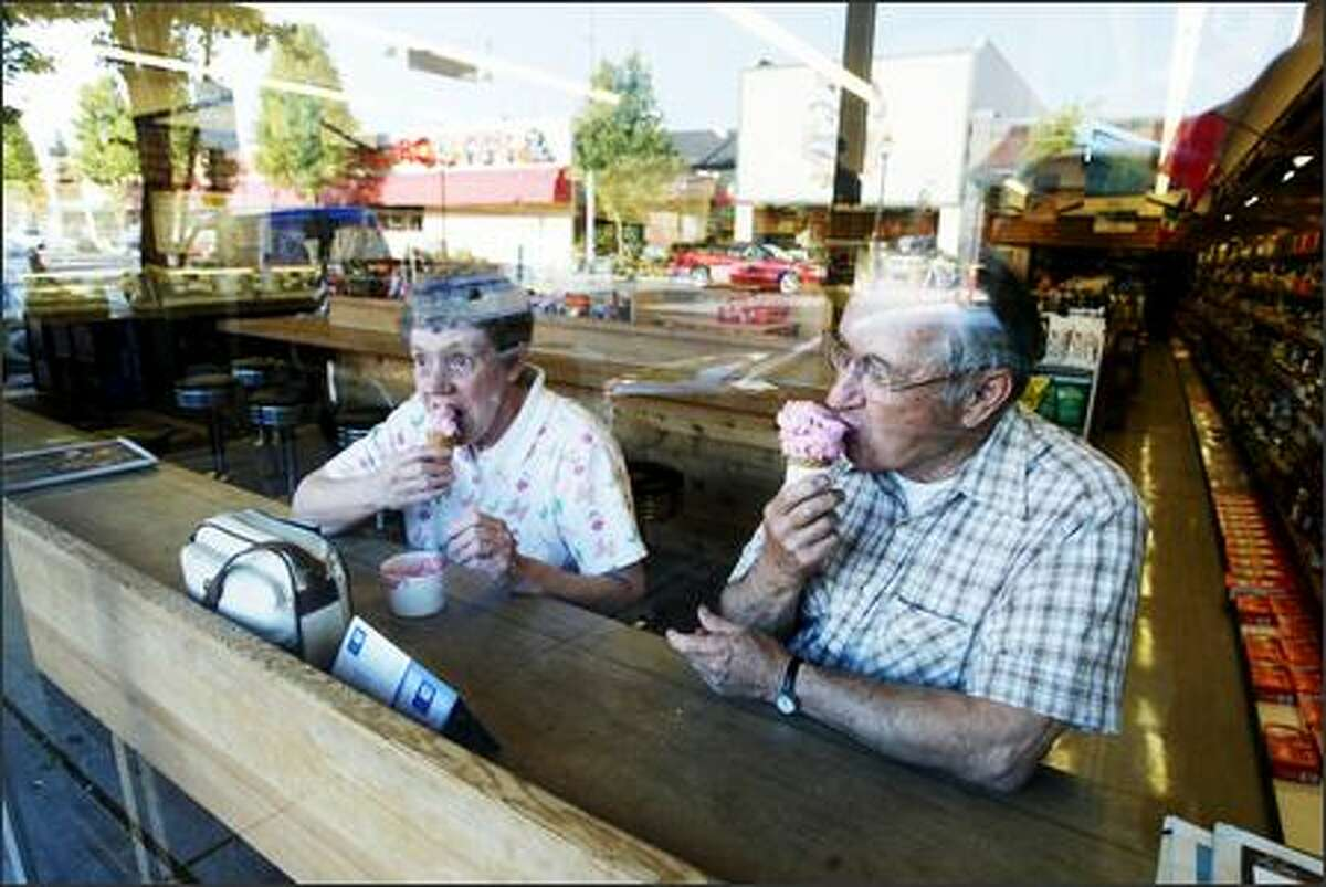 Gene and Patty Kottas of West Seattle enjoy ice cream cones at the Husky Deli, which has been in the same shop for 74 years.