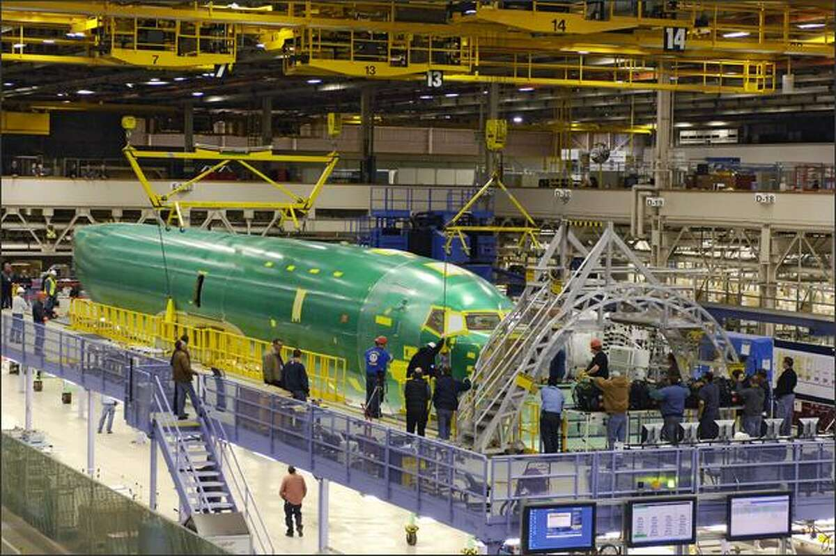 The Boeing Co.'s first P-8A Poseidon fuselage goes into final assembly in Renton. A fleet of the modified 737s will replace the U.S. Navy's aging sub hunters starting next year.