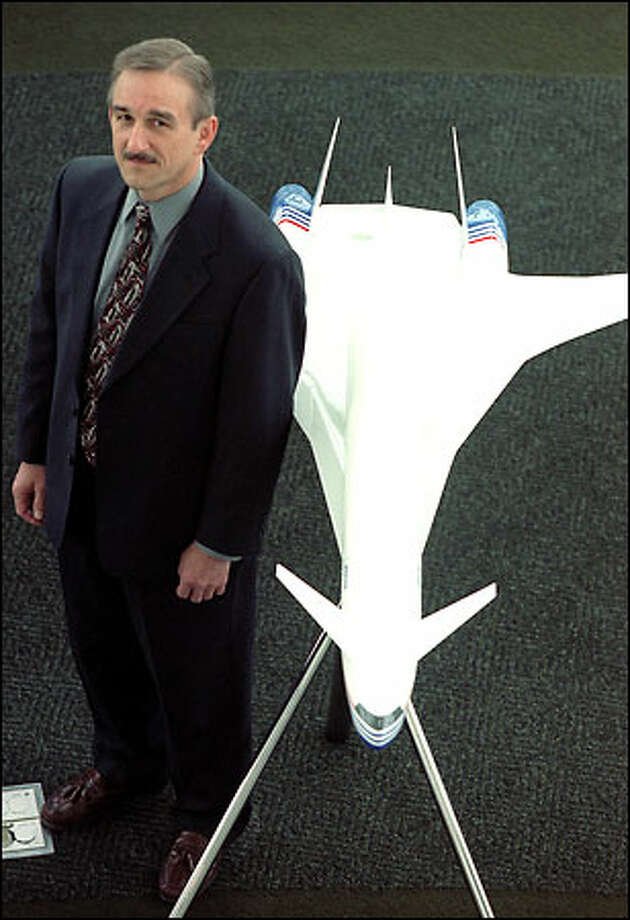 "Tom Waggener, newly named director of marketing for The Boeing Co.'s sonic cruiser program, shows a model of the ultrafast jet. To aid in the development of the sonic cruiser, Waggener has been meeting a core group of about a dozen major airlines around the world that would be potential customers for the plane. ""The major question is how the airlines would use this new plane,"" he says. Photo: Phil H. Webber, Seattle Post-Intelligencer / Seattle Post-Intelligencer"