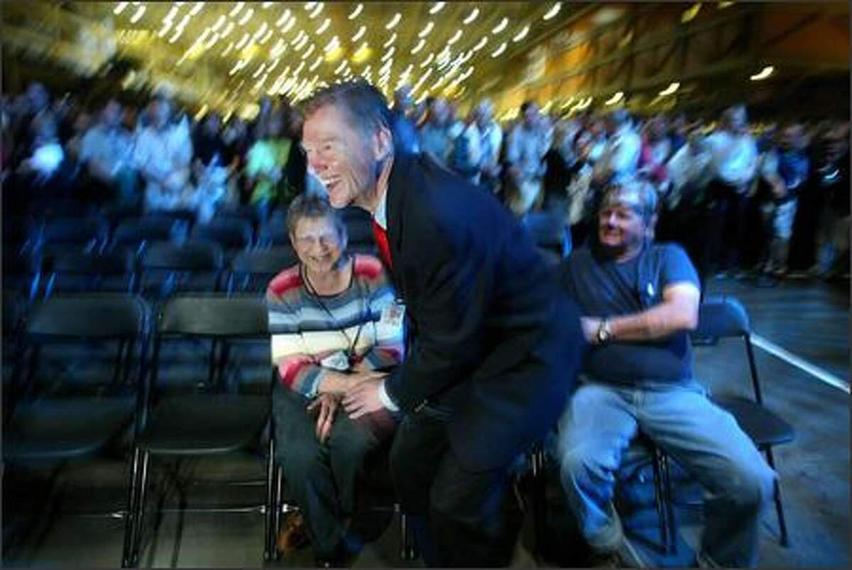 Alan Mulally, chief executive of Boeing Commercial Airplanes, shakes hands with Mary Jo Mazick after speaking to employees in Everett.