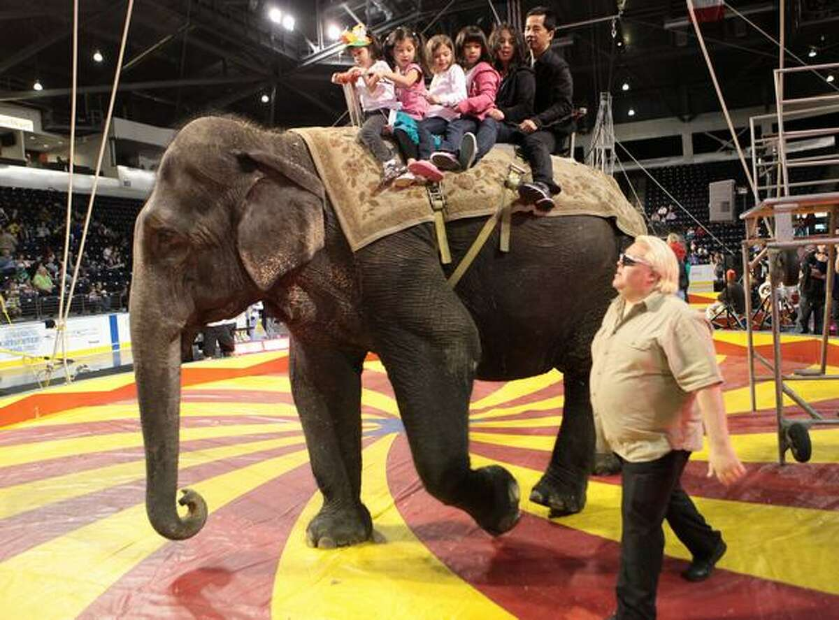 Visitors ride on the back of an elephant during a performance by the Nile Shrine Circus at the ShoWare Center in Kent. The circus recently wrapped up a tour of locations around the Puget Sound.