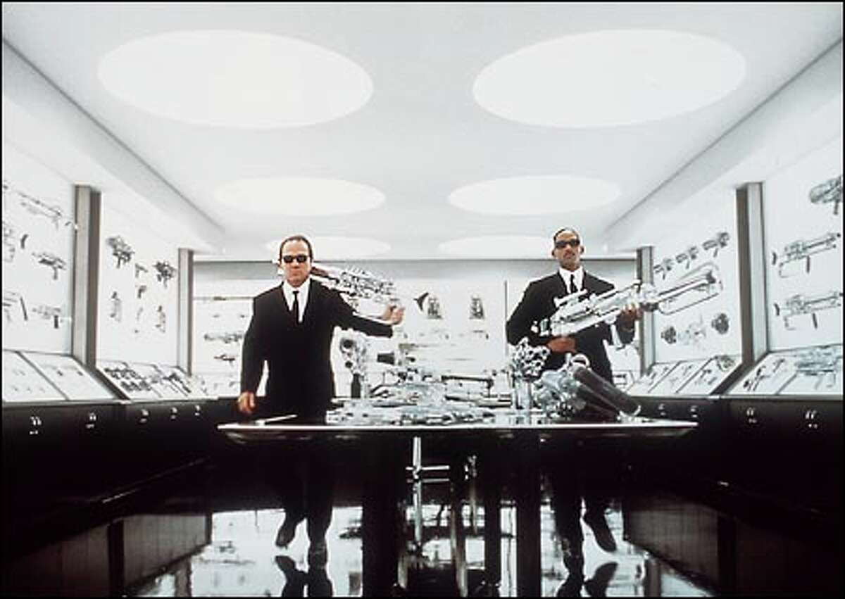 Agents Kay (Tommy Lee Jones), left, and Jay (Will Smith) are together again, and armed for bear, in