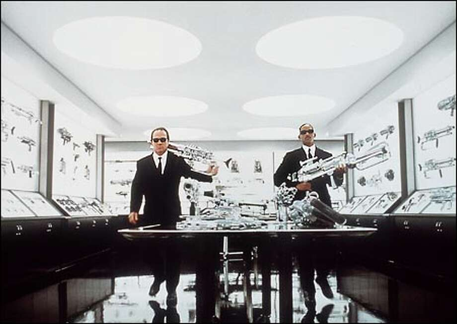 "Agents Kay (Tommy Lee Jones), left, and Jay (Will Smith) are together again, and armed for bear, in ""Men in Black II."""