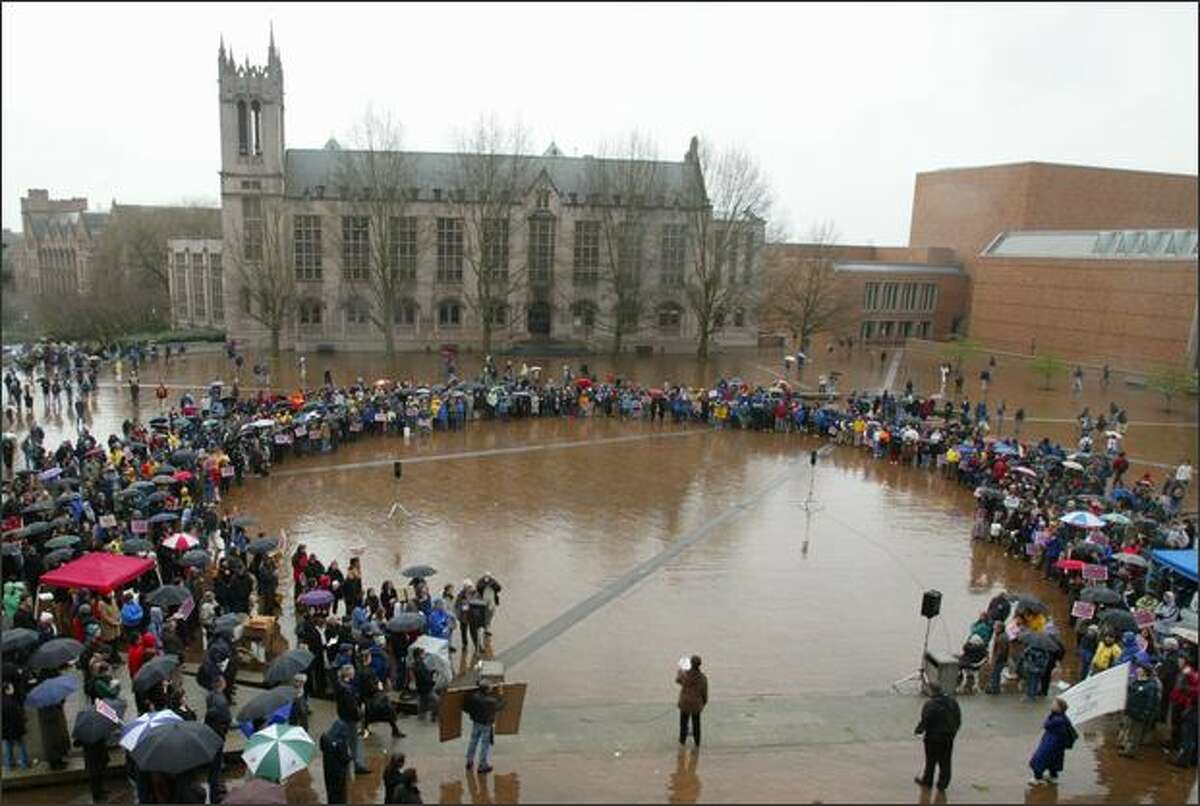 A typical scene at Red Square on the University of Washington campus as students, staff and faculty gather in the rain to protest war in Iraq.