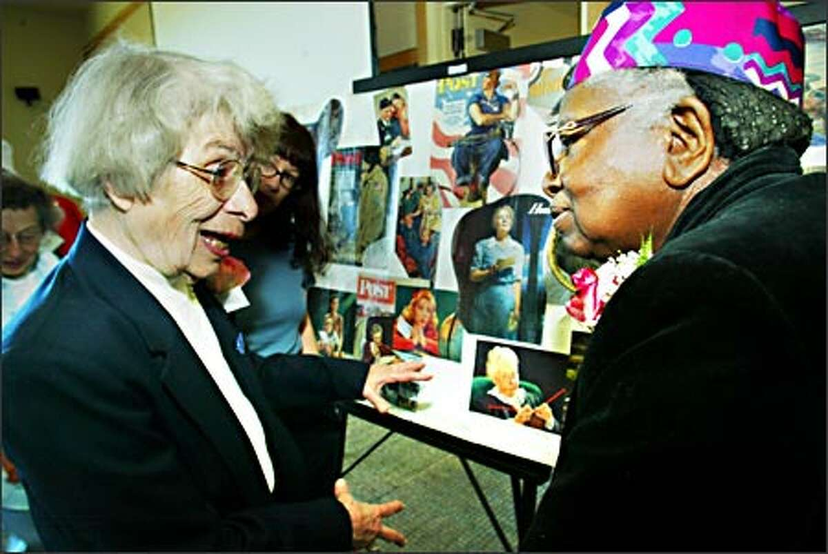 Eleanor Burton, left, who drilled holes for rivets in wings of Boeing B-17s during World War II, talks Friday with Josie E. Dunn, who riveted the B-17 wings at Plant 2. They were among 55 veterans of the war effort who gathered for a luncheon.
