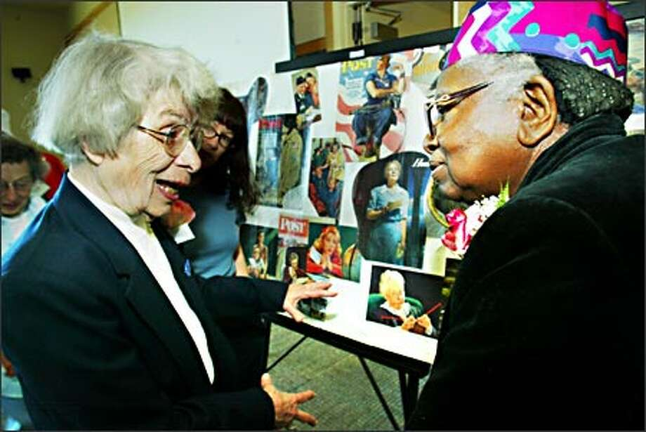 Eleanor Burton, left, who drilled holes for rivets in wings of Boeing B-17s during World War II, talks Friday with Josie E. Dunn, who riveted the B-17 wings at Plant 2. They were among 55 veterans of the war effort who gathered for a luncheon. Photo: Grant M. Haller, Seattle Post-Intelligencer / Seattle Post-Intelligencer