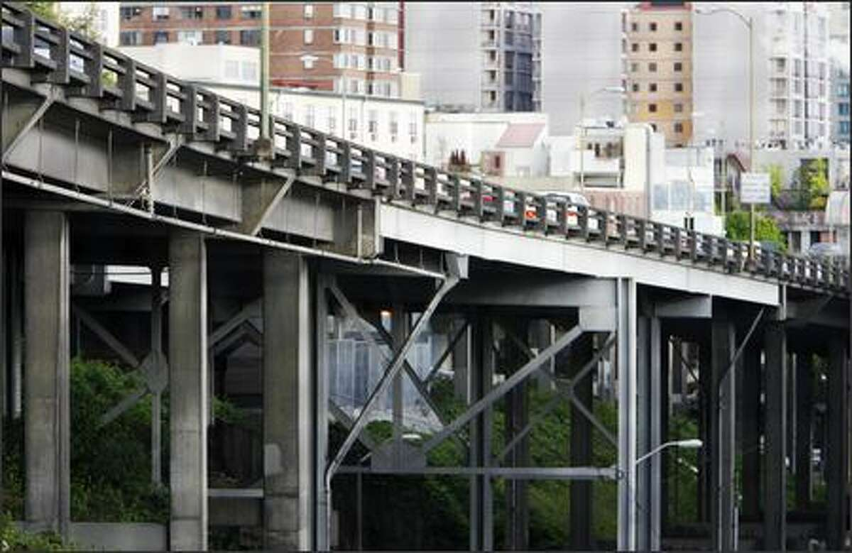 The brutally massive Alaskan Way Viaduct is huge, noisy and has no grace.