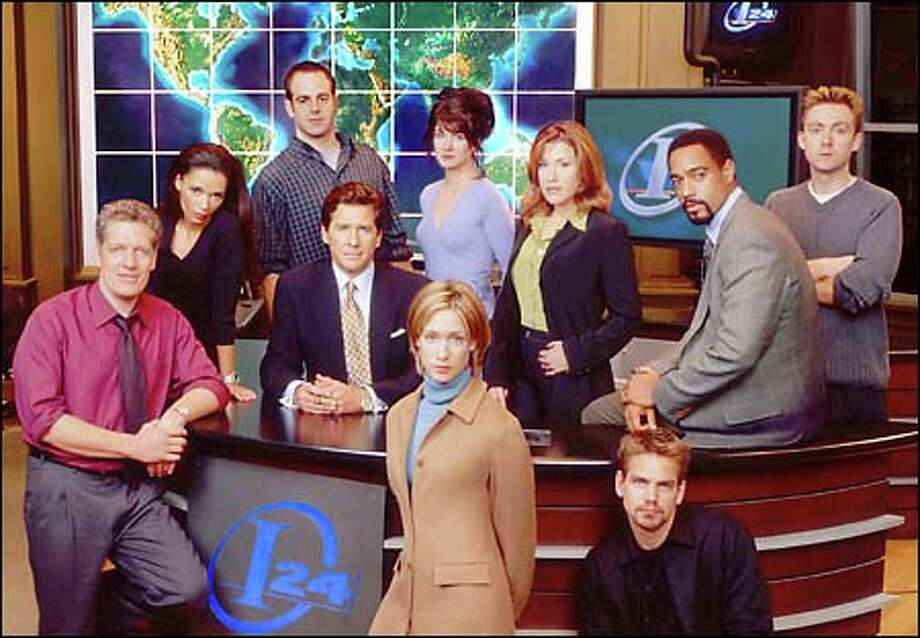 "The cast of ""Breaking News"": Clancy Brown, Rowena King, Paul Adelstein, Tim Matheson, Mindy Crist (standing front), Gabrielle Miller (standing back center), Lisa Ann Walter, Scott Bairstow (seated front), Jeffrey D. Sams, Vincent Gale  (New Line Television/Christain Landry)."