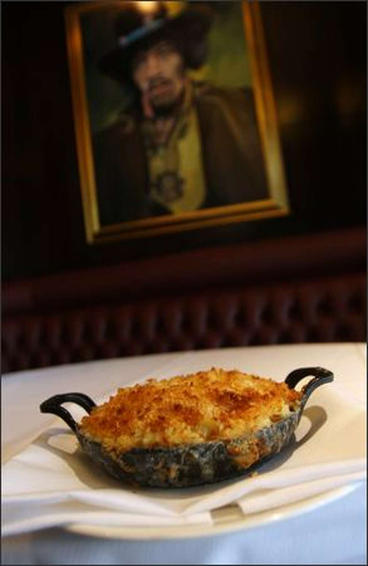 The Grille's lobster/pasta dish offers an outstanding rendition of mac-and-cheese with a trio of cheeses and plenty of lobster. A Jimi Hendrix portrait hangs in the background.