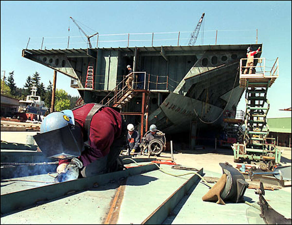 Welder Chris Robinson works on the bow of the Empress of the North, a luxury stern-wheeler being built at the Nichols Bros. Boat Builders in Freeland.