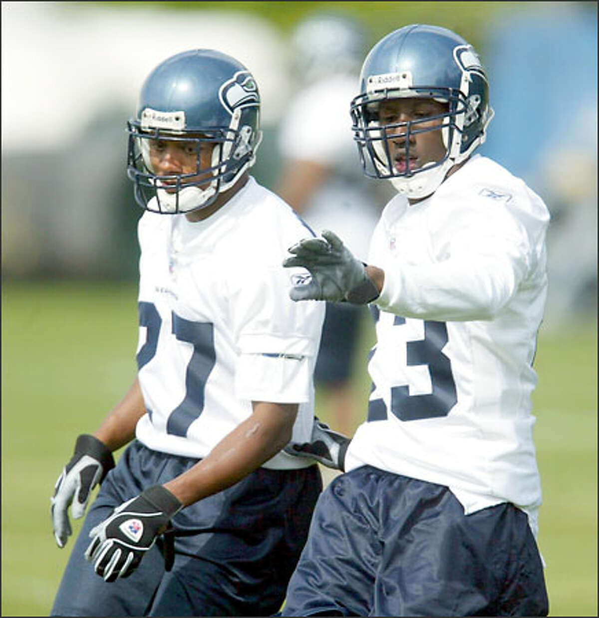 Seattle Seahawks rookie Marcus Trufant goes up against veteran conerback Willie Williams during mini-camp held in Kirkland. Williams signed a one-year contract with the Seahawks Friday, May 2, 2003.