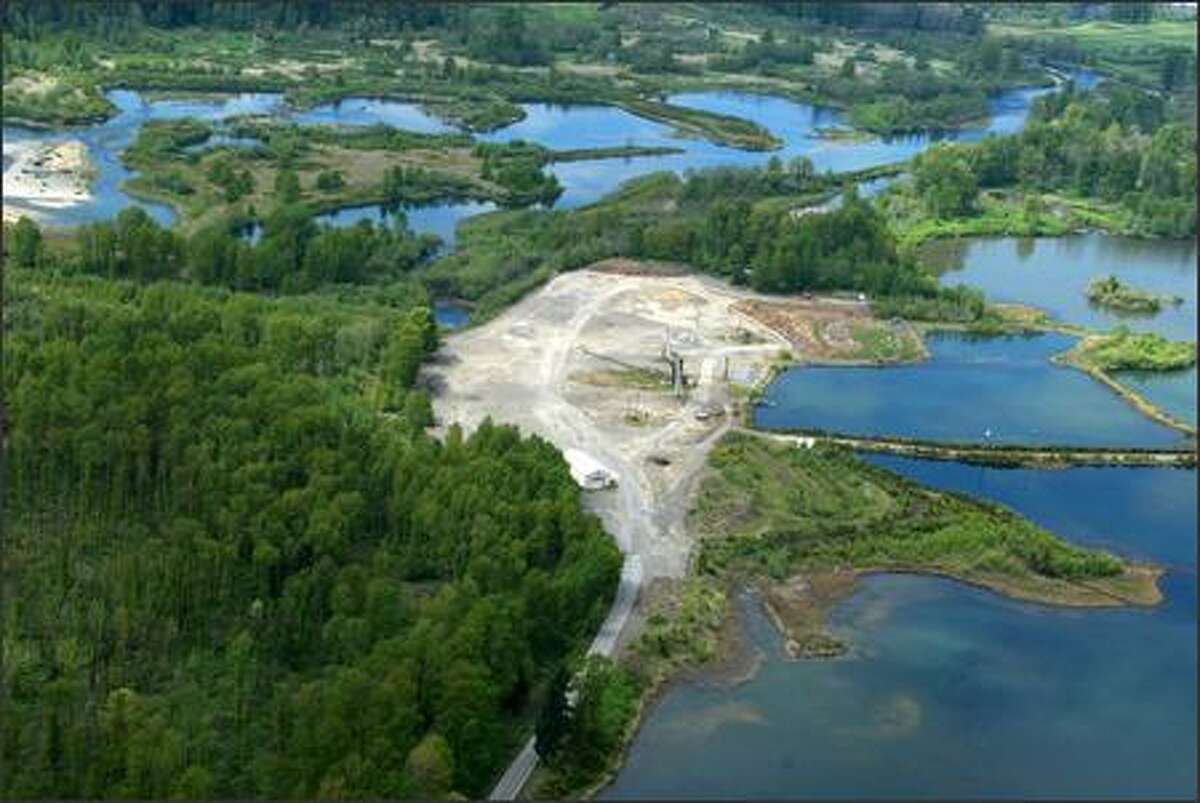 A decade ago, the J.L. Storedahl and Sons gravel mine ate up a half-mile stretch of the East Fork of the Lewis River. The damage remains visible today.