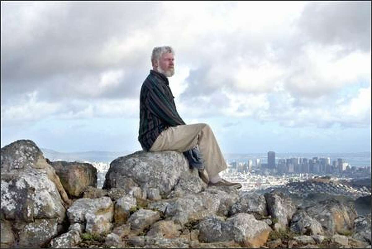 Environmentalist David Schooley, with San Francisco in the background, has led efforts to fix problems with the habitat protection plan at San Bruno Mountain, home to three rare butterfly species.