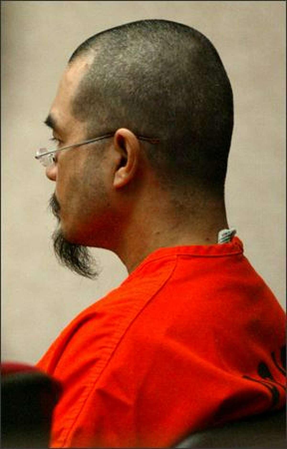 Terapon Adhahn sits motionless during sentencing.