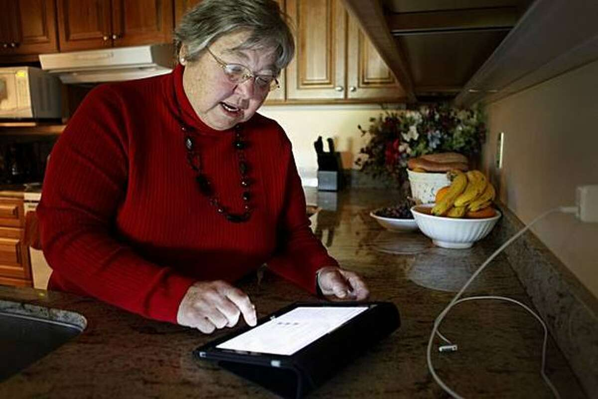 Rita Schena, 78, checks e-mail on her new iPad at her home in Menlo Park, Calif. She finds the iPad easy to read and navigate.